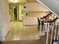 The only access to the family room was through a small doorway, giving the kitchen a closed-in feeling.