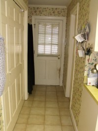 Tight rear hallway with shower stall just inside the back door.