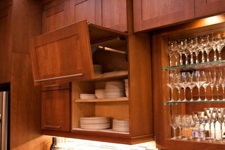Upper cabinets feature lift-up doors, enabling a full view of the contents.
