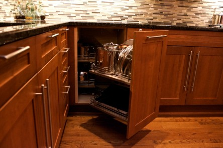 The corner cabinet utilizes a complex drawer system to pull out the interior unit when fully extended.