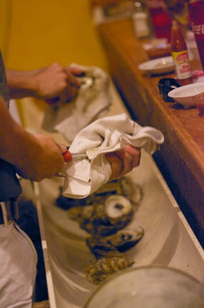 Let them do the work!  Shuckers let customers keep their hands clean while enjoying oysters.