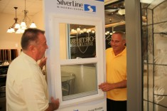 Owners Bill Sinnett, left, and Tim Kern inspect a door on display in the Design Center.