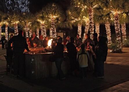 Visitors roast marshmallows at the Jingle Bell Bonfire.