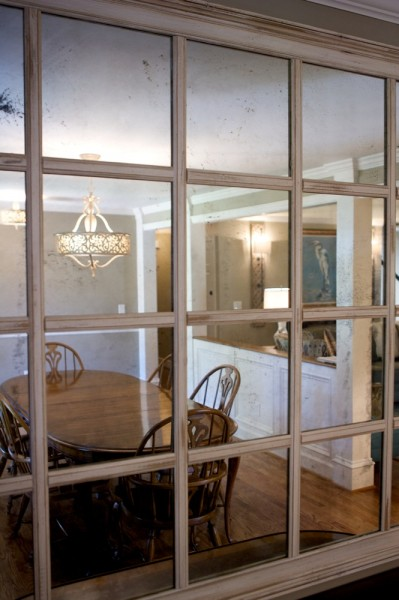 The traditional dining room is reflected in an antiqued, re-purposed mirror.