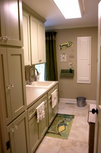 A new laundry room conveniently opens into the new master closet.