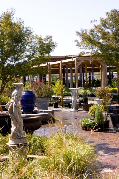 The nursery features a wide variety of plants, urns, fountains, and other outdoor décor.