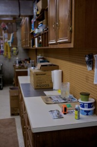 The former kitchen cabinets are re-purposed in Carl's basement workshop.