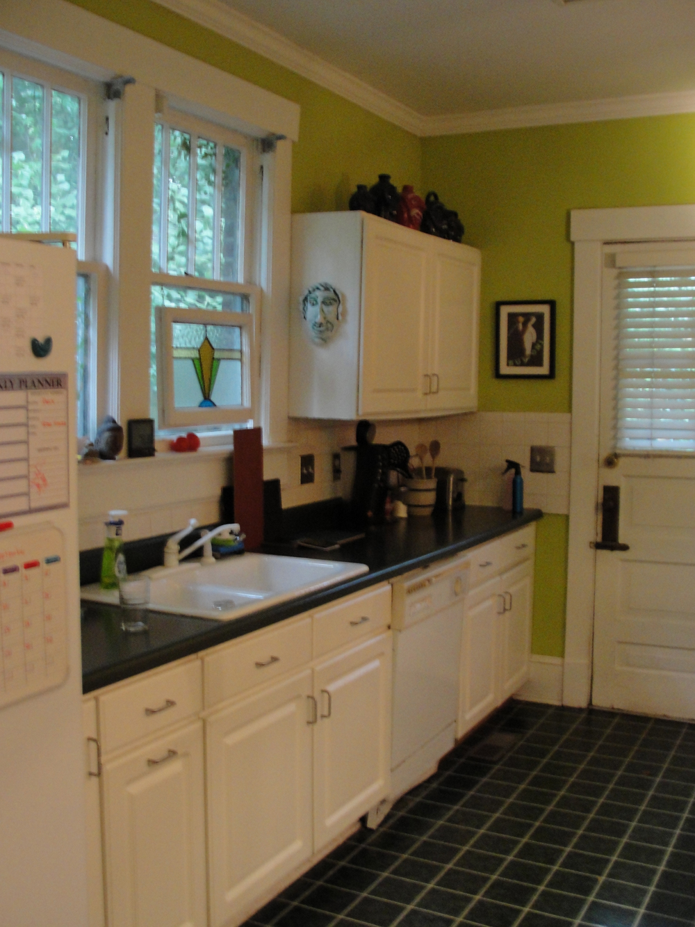 The kitchen as a work of art columbia home garden for Green and white kitchen cabinets