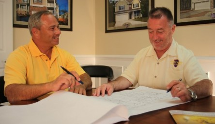 Owners Tim Kern, left, and Bill Sinnett evaluate a set of plans before heading to the job site.
